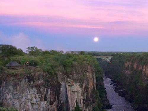 Full moon and the Vic Falls bridge