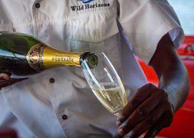 Bubbly on the Malachite Zambezi River Dinner Cruise