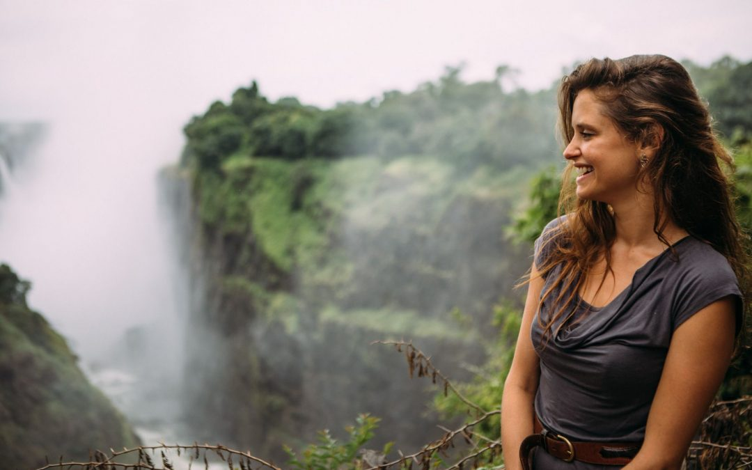 Woman smiling in Victoria Falls rainforest