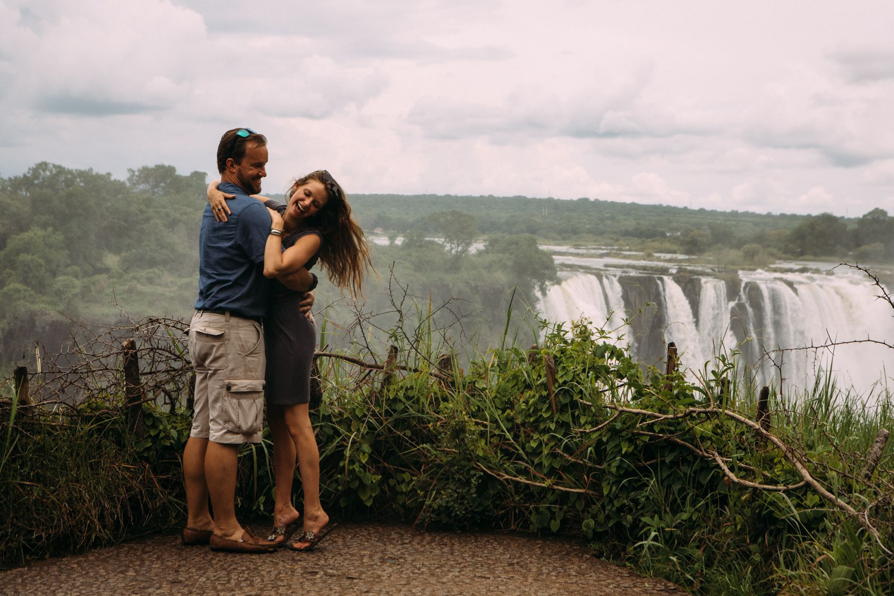 Couple enjoying negative ions Victoria Falls rainforest