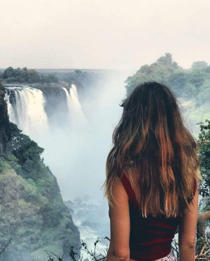 Woman surrounded by negative ions from Victoria Falls waterfall