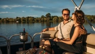 man and women romantic sunset cruise