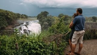 couple touring Victoria Falls